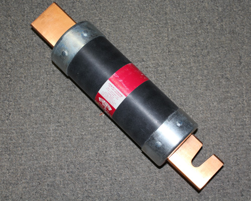 Picture of cartridge 2.88x13.38in time delay fuses.