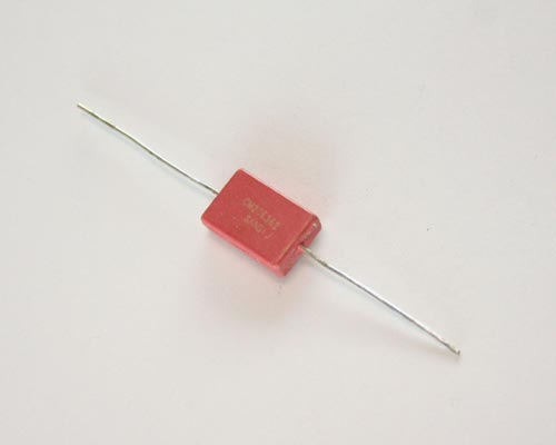Picture of silver mica dipped axial capacitors.